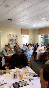 Members enjoy a monthly meeting at River Hills